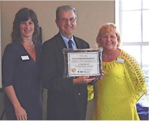 Tracy Levy, SafeSpace director of Development; Dr. Jack Mitchell, St. Lucie Volunteer of the Year; Janet Farnan-Dyer, SafeSpace Resource & Volunteer Coordinator